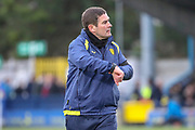 Burton Albion manager Nigel Clough pointing to his watch during the EFL Sky Bet League 1 match between AFC Wimbledon and Burton Albion at the Cherry Red Records Stadium, Kingston, England on 9 February 2019.