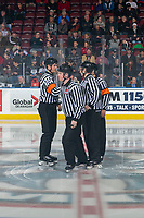 KELOWNA, BC - DECEMBER 27: Referees Tyler Adair and Sean Raphael stand at centre ice with line officials Cody Wanner and Dave McMahon at the Kelowna Rockets against the Kamloops Blazers at Prospera Place on December 27, 2019 in Kelowna, Canada. (Photo by Marissa Baecker/Shoot the Breeze)