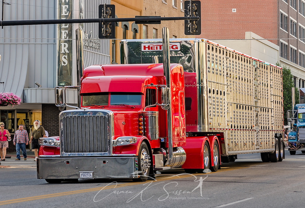 A 2015 Peterbilt 389 with a Wilson cattle trailer represents Heitzig Trucking during the 34th annual Shell Rotella SuperRigs parade, June 10, 2016, in Joplin, Missouri. SuperRigs, organized by Shell Oil Company, is an annual beauty contest for working trucks. Approximately 89 trucks entered this year's competition. (Photo by Carmen K. Sisson/Cloudybright)