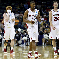Mar 24, 2011; New Orleans, LA; Wisconsin Badgers guard Jordan Taylor (center), Wisconsin Badgers forward Tim Jarmusz (right) and forward Mike Bruesewitz (left) walk off the court following a loss to the Butler Bulldogs  in the semifinals of the southeast regional of the 2011 NCAA men's basketball tournament at New Orleans Arena. Butler defeated Wisconsin 61-54.  Mandatory Credit: Derick E. Hingle