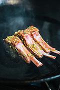 Cooking grilled marinated lamb chop (chien sach chien) at The Royal Dynasty restaurant at the Raffles Grand Hotel d'Angkor, Siem Reap
