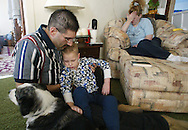 Kraig Murphy tries to settle Austin's limp body in his lap to give Crystal a break. Two months after being diagnosed with ALD, Austin cannot support his body weight because of the rapid deterioration. Austin once only wanted to be touched by his mother. Now that he is no longer aware of his surroundings, almost anyone can hold him.