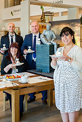 Left to right Events Fundraiser Ash Corker, Rotherham Hospice Fundraising Team Leader Anne Giblin, Oak Furniture Land Rotherham Store Manager Jez Groom and Cake Artist Rose Dummer enjoy a Celebration Breakfast with Man of Steel at the opening of the Oak Furniture Land Rotherham Store. The cake will be donated to Rotherham Hospice who will use it to help raise funds<br /> <br /> 3 June 2015<br />  Image &copy; Paul David Drabble <br />  www.pauldaviddrabble.co.uk