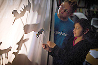 Devin Ekness, 10, and his classmate Mia Maldonado, 9, play with their shadow puppets during class Friday at Ponderosa Elementary in Post Falls.