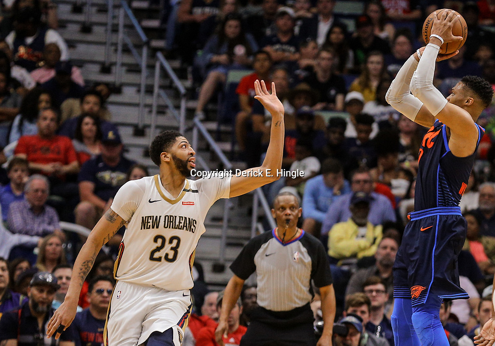 Apr 1, 2018; New Orleans, LA, USA; Oklahoma City Thunder guard Russell Westbrook (0) shoots over New Orleans Pelicans forward Anthony Davis (23) during the second half at the Smoothie King Center. The Thunder defeated the Pelicans 109-104. Mandatory Credit: Derick E. Hingle-USA TODAY Sports