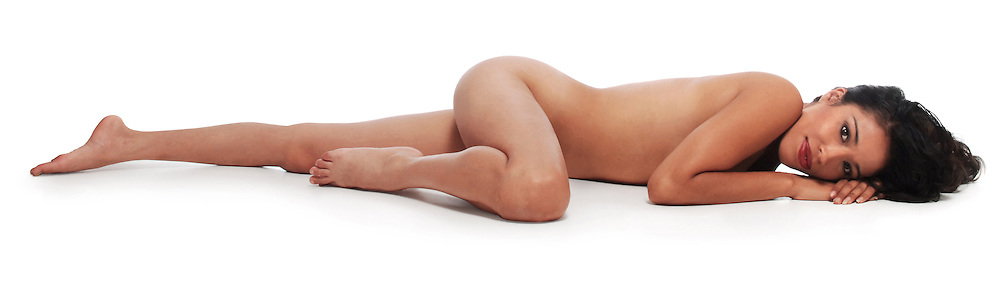 beautiful woman lying on white seamless background eyes open