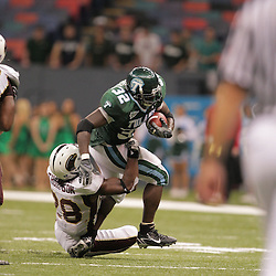 20 September 2008: Tulane running back Andre Anderson (32) is tackled by Louisiana-Monroe defensive back Josh Thompson (28) during a Conference USA match up between the University of Louisiana Monroe and Tulane at the Louisiana Superdome in New Orleans, LA.