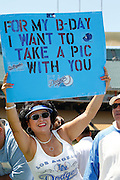 LOS ANGELES, CA - JUNE 30:  A fan holds up a sign asking for a birthday photo at fan photo day before the Los Angeles Dodgers game against the New York Mets on Saturday, June 30, 2012 at Dodger Stadium in Los Angeles, California. The Mets won the game in a 5-0 shutout. (Photo by Paul Spinelli/MLB Photos via Getty Images)