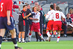 OSLO, NORWAY - Wednesday, September 5, 2001: Wales' Robbie Savage celebrates scoring the opening goal against Norway with manager Mark Hughes during the FIFA World Cup 2002 Qualifying Group 5 match at the Ullevaal Stadion. (Pic by David Rawcliffe/Propaganda)