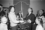 21/08/1966<br /> 08/21/1966<br /> 21 August 1966<br /> European Sea Angling Championship at Howth, Dublin. Picture shows Mr. Charles Haughey (right), Minister for Agriculture and Fisheries, presenting the Ladies Prize to Mrs. Pat Hannon of Woodbine Sea Angling Club at the reception in the Lawrence hotel after the competition. In the centre is Mr. Alec Webster, Organiser.