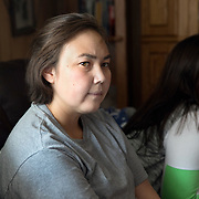 (L-R) Diana Nayokpuk and Hillary Sinnok,at home in Shishmaref, Alaska, an Inupiat community of about 600 people near the Bering Strait. Shishmaref is one of at least 31 Alaska Native villages under imminent threat due to climate change, according to a 2009 report from the Government Accountability Office. Shishmaref is steadily disappearing because of erosion and flooding due to climate change. Only one quarter mile wide and two and half miles long, Shishmaref has been  grappling with rising sea levels that have eroded more than 200 feet of the village, since 1969, according to a relocation study published in February. Climate change has resulted in a reduction in the sea ice which buffers Shishmaref from storm surges. At the same time, the permafrost that the village is built on has also begun to melt, making the shore even more vulnerable to erosion.