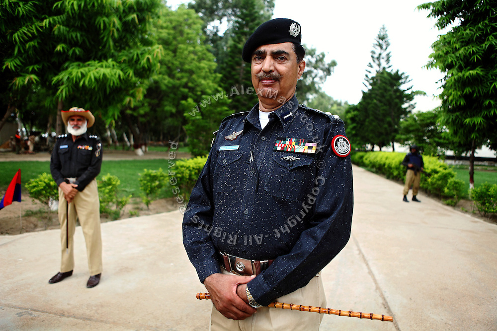 Colonel Abdul Wahid Khan (center) is posing for a portrait inside the Shaheed Benazir Bhutto Elite Police Training Center, a commando and anti-terrorism academy on the outskirts of Karachi. The training center was founded by retired colonel Abdul Wahid Khan, a brave officer who served as a gunship helicopter pilot in the Pakistani Air Force and around the globe with the United Nations, but who's first task as a young army officer in 1979 was to train Afghan Mujahedeen to fight the Soviet Army, the very Mujahedeen that are today's Taleban.