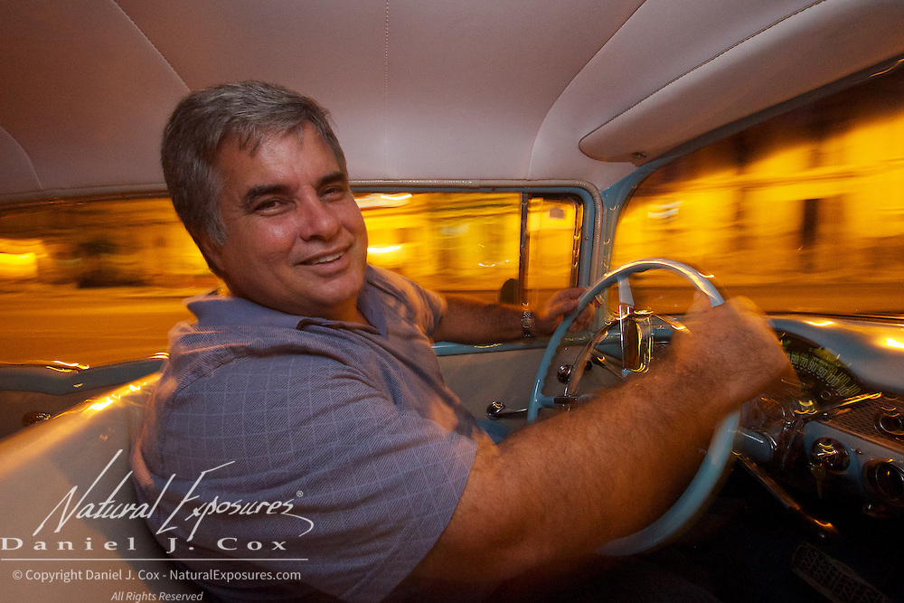 Julio Alvarez Torres driving his 55 Chevy Bel Air, Havana, Cuba
