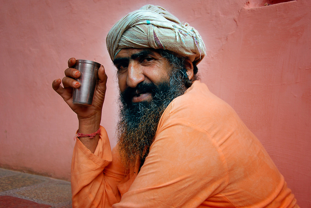 Indian holy man (saddhu) drinks traditional tea (chai) in an ashram in Rajasthan.