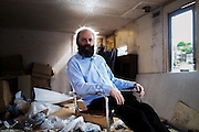 Artist Gavin Turk portrait in a caravan at the back of his studios ahead of  the art fair car boot sale.<br /> <br /> photos by Ki Price
