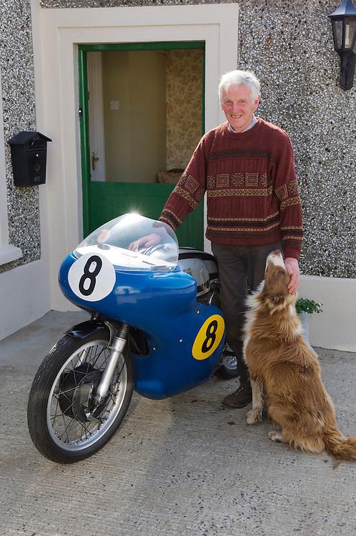 Veteran motorcycle road race champion Richard Creith with his 500cc Manx Norton at his farm at Bushmills, Northern Ireland.