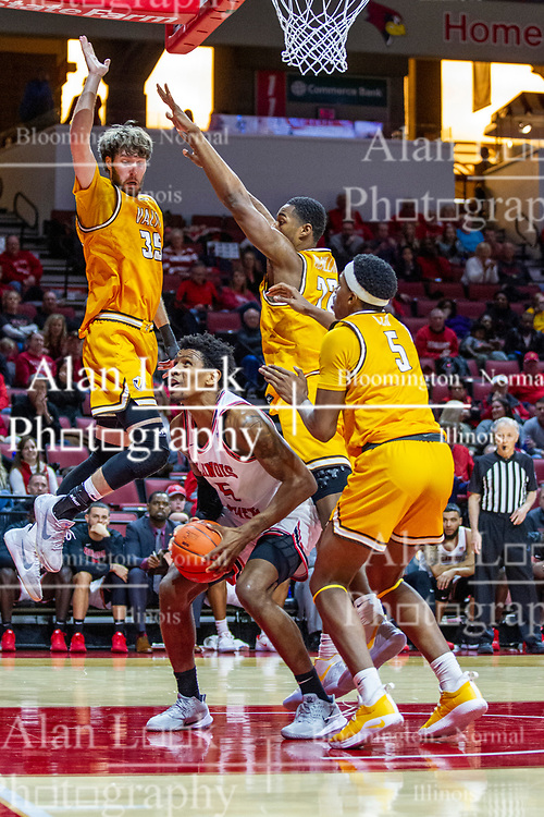 NORMAL, IL - February 15: Keith Fisher III looks patiently for a shot while triple teamed by Ryan Fazekas, Mileek McMillan and Donovan Clay during a college basketball game between the ISU Redbirds and the Valparaiso Crusaders on February 15 2020 at Redbird Arena in Normal, IL. (Photo by Alan Look)