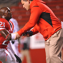 Oct 16, 2009; Piscataway, NJ, USA; Rutgers head coach Greg Schiano shakes cornerback Devin Mccourty's (21) hand during warmups before an NCAA football game between Rutgers and Pittsburgh at Rutgers Stadium