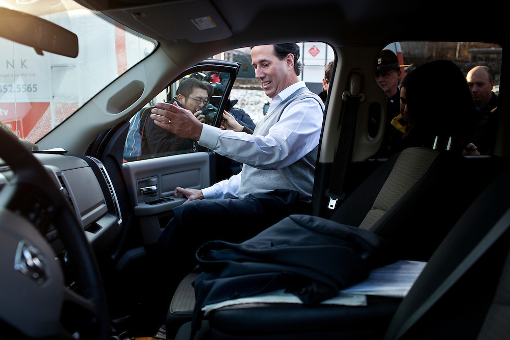 Republican presidential candidate Rick Santorum gets in his truck after speaking at a town hall meeting on Friday, January 6, 2012 in Dublin, NH.