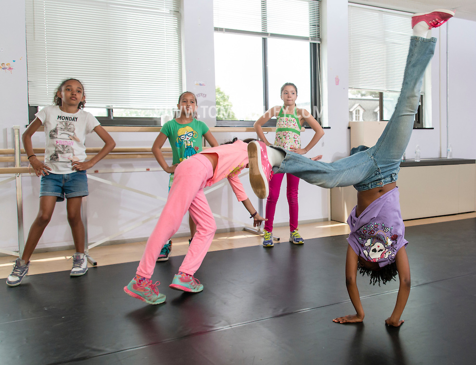 Middletown, New York - Girls enjoy the Girls Rock (YMCA Steppers) class at the Middletown YMCA's Center for Youth Programs on May 9, 2015.