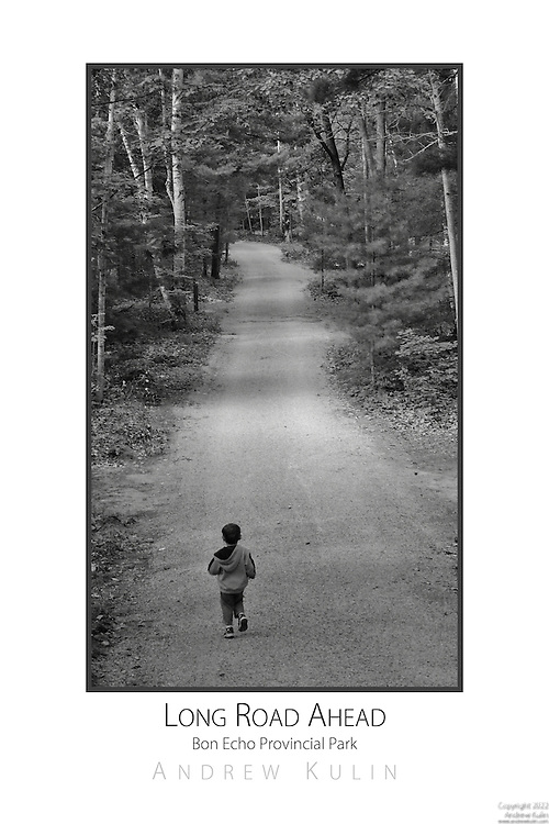 Toddler walking down a campground road.