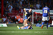 Kevin Bru suffering from cramp during the Sky Bet Championship match between Brentford and Ipswich Town at Griffin Park, London, England on 8 August 2015. Photo by Matthew Redman.