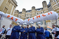 © Licensed to London News Pictures. 17/10/2017. London, UK. Public sector workers, several wearing masks depicting Theresa May, Prime Minister, as a 'MayBot' outside the Department of Health ahead of a rally in Parliament Square against the cap on public sector worker's' pay. Photo credit : Stephen Chung/LNP