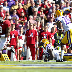 November 6, 2010; Baton Rouge, LA, USA; Alabama Crimson Tide running back Trent Richardson (3) breaks away from LSU Tigers linebacker Ryan Baker (22) and safety Brandon Taylor (15) during the first half at Tiger Stadium.  Mandatory Credit: Derick E. Hingle
