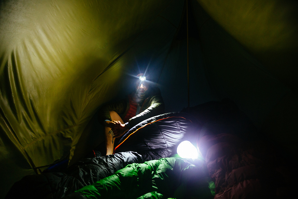 Matt Hines getting ready for sleep in a humid tent from the new rain.