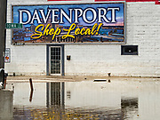 10 MAY 2019 - DAVENPORT, IOWA: A store in Davenport in a flooded parking lot. The Davenport riverfront and downtown flooded on 30 April 2019 when a levee on the Mississippi River failed, allowing the river to flow into Davenport. Parts of downtown are still flooded, nearly two weeks after the levee failed. The river crested at 22.7 feet above flood stage, setting a new record. The previous highest flood stage was 22.63, set in 1993.     PHOTO BY JACK KURTZ