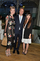 Left to right, ?, TOM HOOPER and ZARA MARTIN at The Women for Women International & De Beers Summer Evening held at The Royal Opera House, Covent Garden, London on 23rd June 2014.