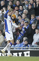 Photo: Aidan Ellis.<br /> Blackburn Rovers v Arsenal. The Barclays Premiership. 25/02/2006.<br /> Blackburn's Morten Gamst Pedersen waves to the crowd as he goes off injured after scoring the first goal