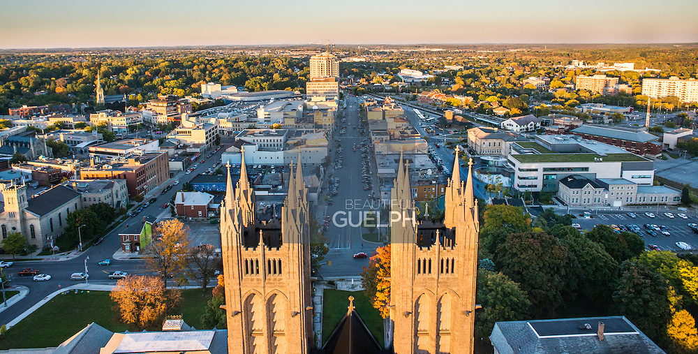 Another angle of our popular 'Sentinels' photograph of the Basilica using a drone.  This version shows City hall, and all of downtown Guelph from directly behind the spires of the Basilica of our Lady.  Photo by Eye Fly Media.