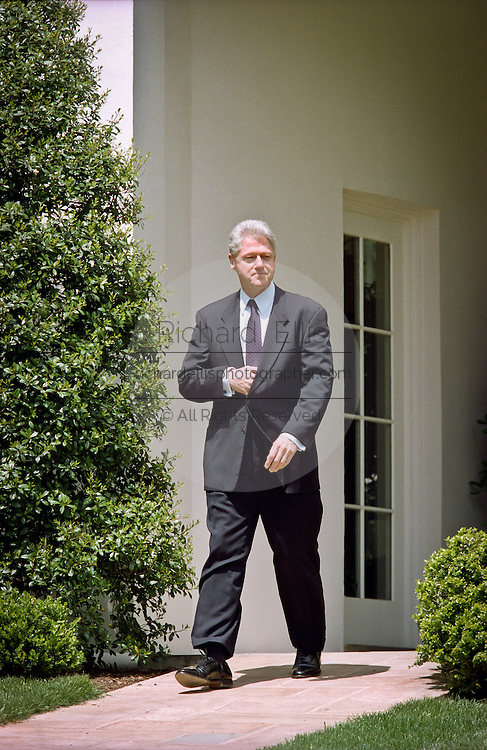 President Bill Clinton walks out from the Oval Office to address reporters behind the Oval Office about his discussions with Congressional leaders on the Kosovo situation April 28, 1999. The president reaffirmed his commitment to support NATO military actions in coming months.