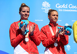 England's Alicia Blagg (right) and Katherine Torrance with their silver medals for the Women's Synchronised 3m Springboard Final at the Optus Aquatic Centre during day seven of the 2018 Commonwealth Games in the Gold Coast, Australia.