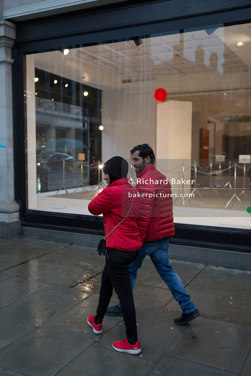 Shoppers walk past a window display that is part of a design theme called 'State of the Arts', at the Selfridges department store on Oxford Street, on 4th March 2019, in London England. State of the Arts is a gallery of works by nine crtically-acclaimed artists in Selfridges windows to celebrate the power of public art. Each of the artists are involved in creating a site-specific artwork at one of the new Elizabeth line stations as part of the Crossrail Art Programme.