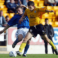 St Johnstone v Raith Rovers....20.09.03<br />Keigan Parker tackles Craig Stanley<br /><br />Picture by Graeme Hart<br />Perthshire Picture Agency<br />Tel: 01738 623350 / 07990 594431