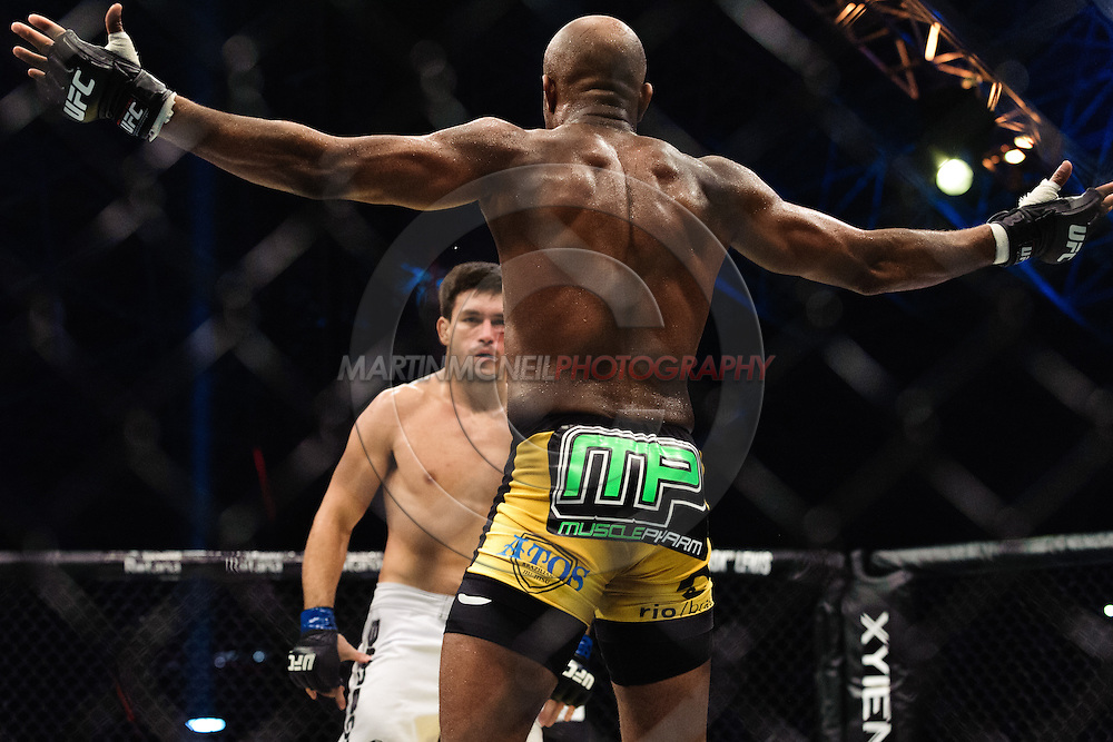 """ABU DHABI, UNITED ARAB EMIRATES, APRIL 10, 2010: Anderson Silva (black/yellow trunks) taunts Demian Maia (white shorts) are pictured at """"UFC 112: Invincible"""" inside Ferari World, Abu Dhabi on April 10, 2010"""