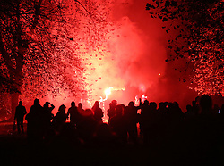© Licensed to London News Pictures. 05/11/2015. London, UK. Anti-capitalist protestors light a flare in St James' Park during the Million Mask march. Photo credit: Peter Macdiarmid/LNP