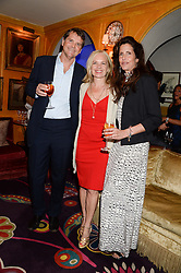 Left to right, BARNABY THOMPSON, MARIELLA FROSTRUP and CHRISTINA THOMPSON at the launch of Bluehouse, Samsung's Exclusive New members Club held at Annabel's, 44 Berkeley Square, London on 1st July 2013.