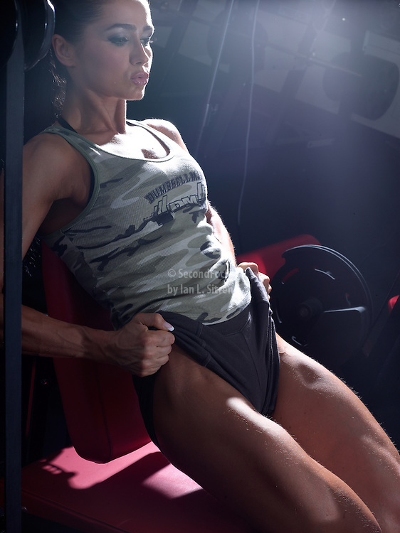 Sasha Brown doing leg extensions in the gym