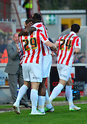 Cheltenham players celebrate Shaun harrad's first goal during the Sky Bet League 2 match between Cheltenham Town and Cambridge United at Whaddon Road, Cheltenham, England on 14 April 2015. Photo by Alan Franklin.