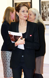 Image licensed to i-Images Picture Agency. 12/06/2014. Angelina Jolie tours an art exhibition  on day three of the End Sexual Violence in Conflict  Global Summit in London.  Picture by Stephen Lock / i-Images
