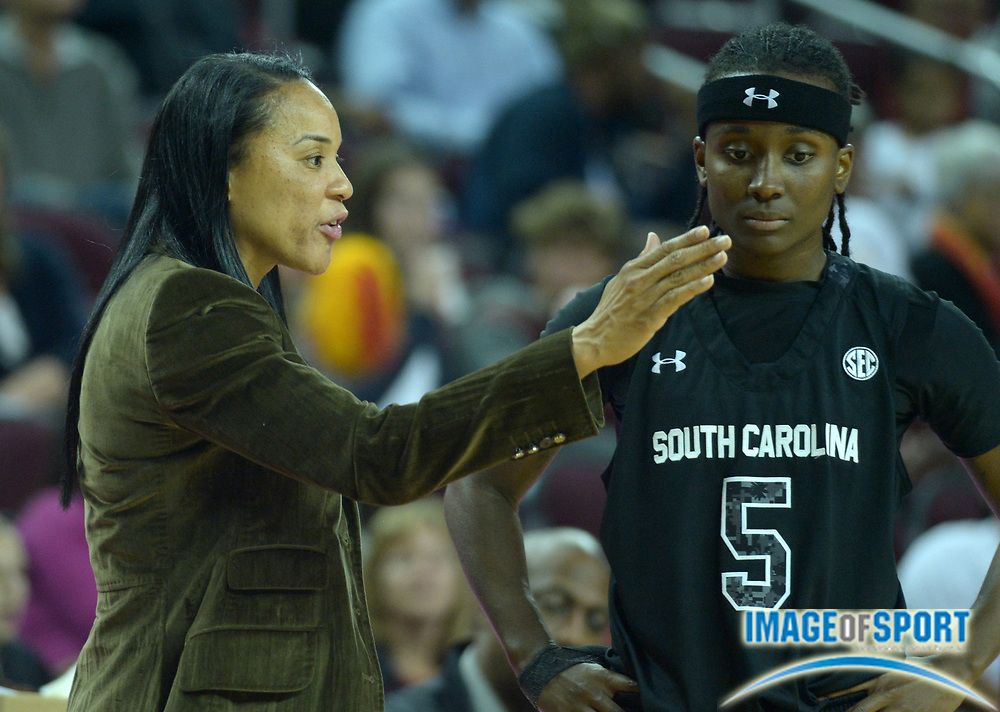 Nov 25, 2013; Los Angeles, CA, USA; South Carolina Gamecocks coach Dawn Staley (left) and guard Khadijah Sessions (5) during the game against the Southern California Trojans at Galen Center. South Carolina defeated Southern California 70-50.
