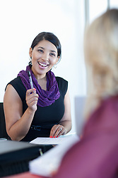 Businesswoman smiling in meeting (Credit Image: © Image Source/Albert Van Rosendaa/Image Source/ZUMAPRESS.com)
