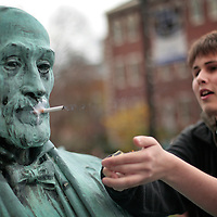 "November 19, 2009 - Lexington, Kentucky, USA - University of Kentucky sophomore BRIAN REIFERT, lit a cigarette he had taped to the mouth of a statue of UK's first president, JAMES PATTERSON, as he and other students have a ""smoke-out"" to protest the University's tobacco ban on campus which began today. About a hundred student smokers and non-smokers gathered to protest the campus-wide tobacco ban UK implemented Thursday by continuously using tobacco products in front of Patterson Office Tower and on the Student Center patio. The ban prohibits the use of cigarettes, pipes, cigars and chewing tobacco, and extends to all properties owned by the university in Fayette County. (Credit image: © David Stephenson/ZUMA Press)"