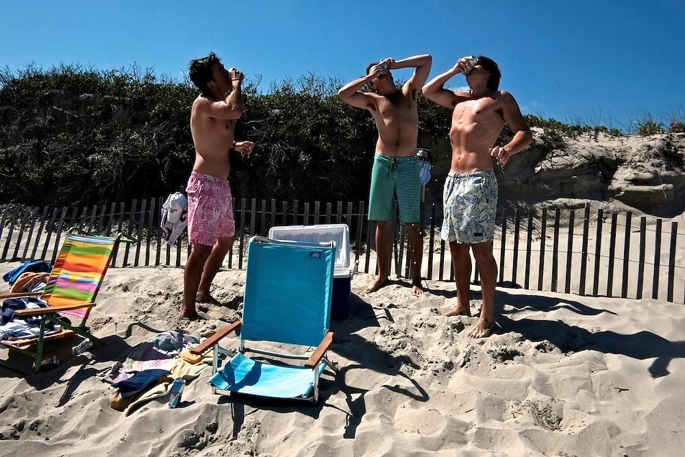 Shotgunning beers, Narragansett Beach. Narragansett, RI