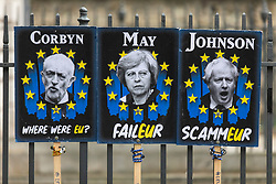 © Licensed to London News Pictures. 02/04/2019. London, UK. Anti-Brexit protest placards attached to a fence opposite Parliament, as Prime Minister Theresa May chairs a Cabinet meeting to try and agree a path forward with ministers. MPs have voted to reject all alternatives to the Withdrawal Agreement for a second time. Photo credit: Rob Pinney/LNP