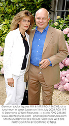 German social figures MR & MRS ROLF SACHS, at a luncheon in West Sussex on 14th July 2002.	PCB 119