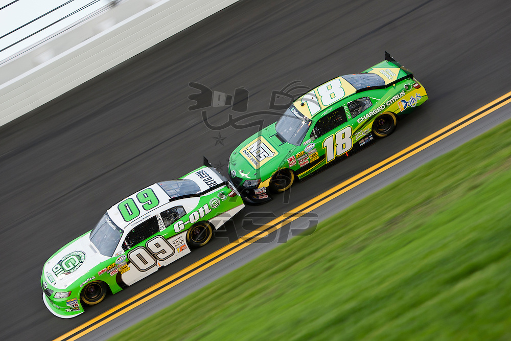 Daytona Beach, FL - July 01, 2011: Kenny Wallace (09) and Kyle Busch (18) race off turn four during the Subway Jalapeno 250 at Daytona International Speedway in Daytona Beach, FL.
